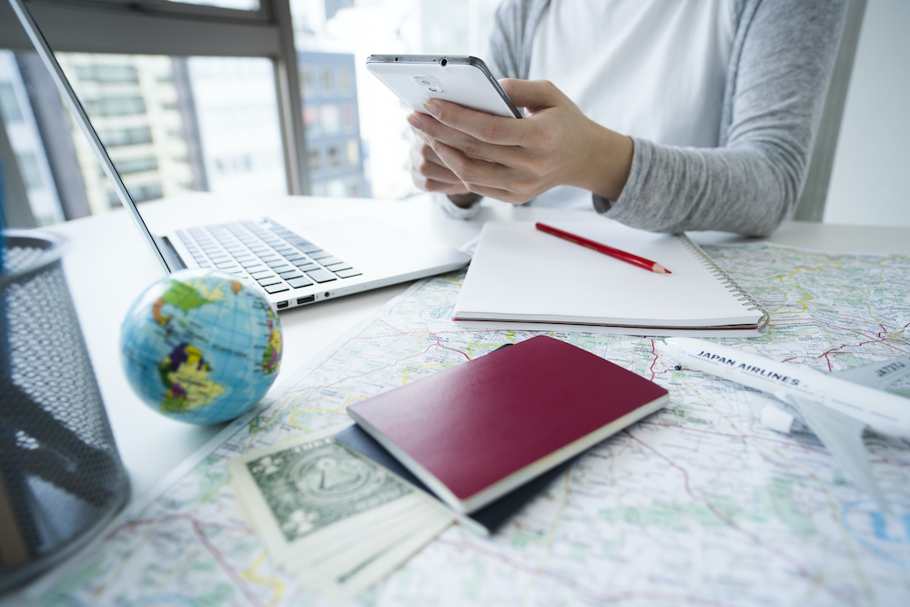 Women are collecting information on travel destinations with smartphones