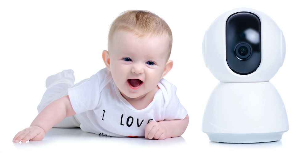 Baby with baby monitor camera